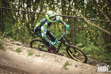 A Downhill racer is taking a corner in Bike Park Spaarnwoude