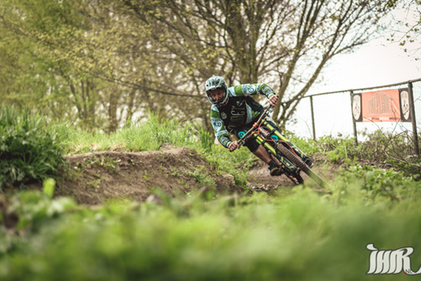 A Downhill Racer making corners in Bike Park Spaarnwoude