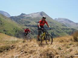 ION Bike Short Sabotage biking on a Ridge line in Les 2 Alps