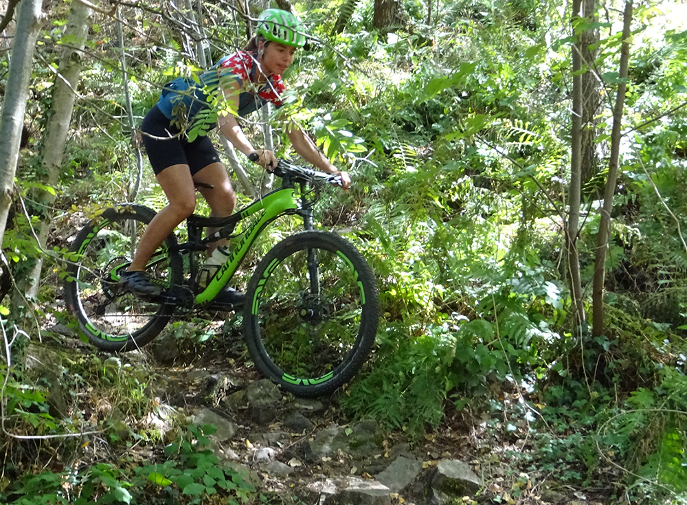 A girl on a Cannondale rides some rocky trails